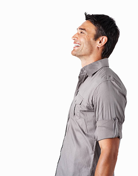 Profile of a smiling mid adult man against white stock photo