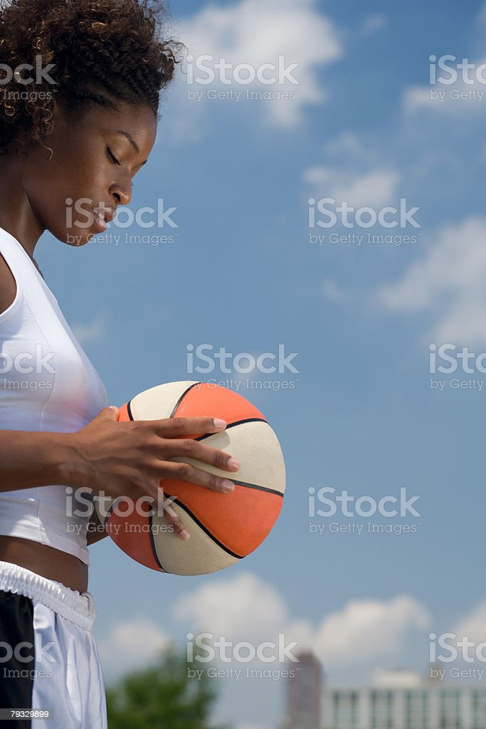 Profile of a woman holding a basketball royalty-free 스톡 사진