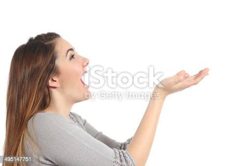 istock Profile of a woman holding something blank surprised 495147751
