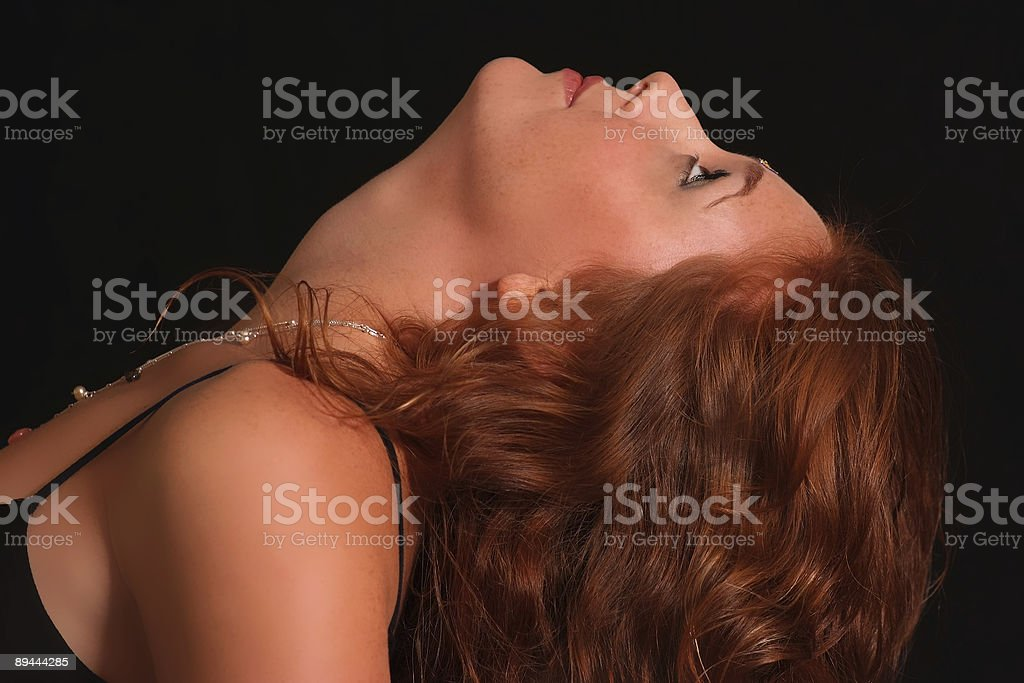 Profile of a woman looking up royalty-free stock photo