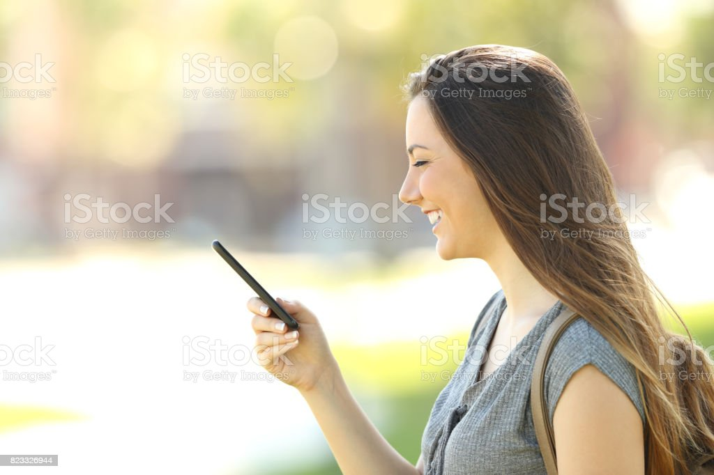 Profile of a woman using a mobile phone stock photo