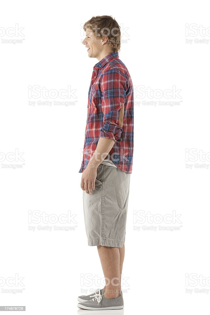 Profile of a young man standing stock photo
