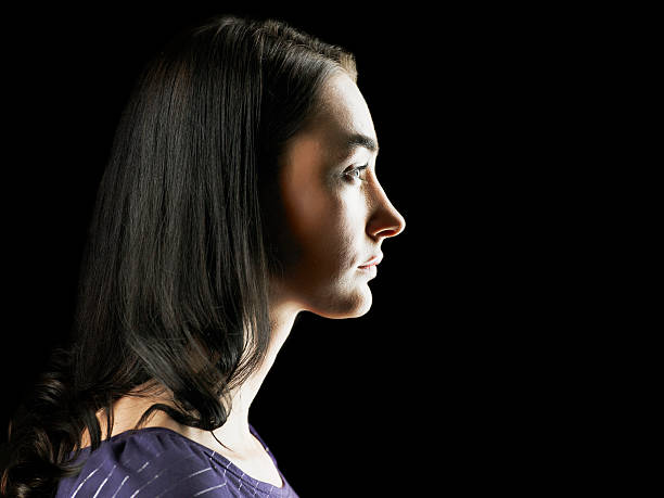 profile of a young woman - profile view stock photos and pictures