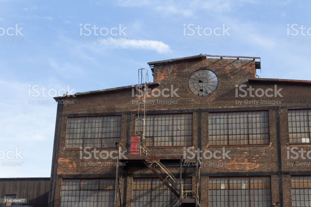 Profile Of An Abandoned Industrial Building Circular Window