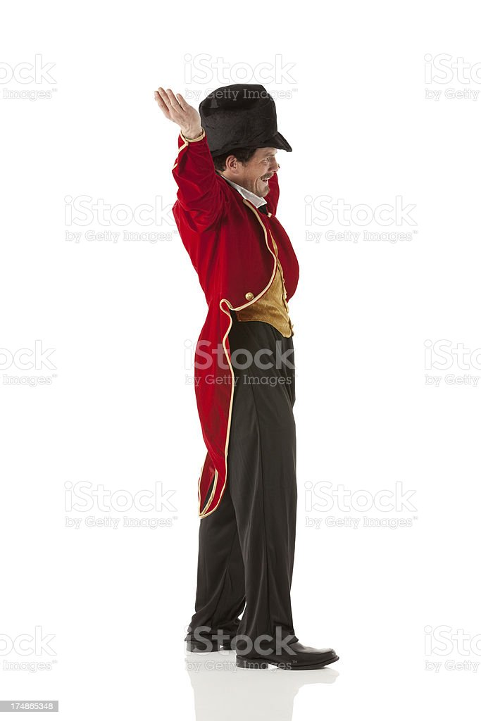 Profile of an animal tamer with hands raised stock photo