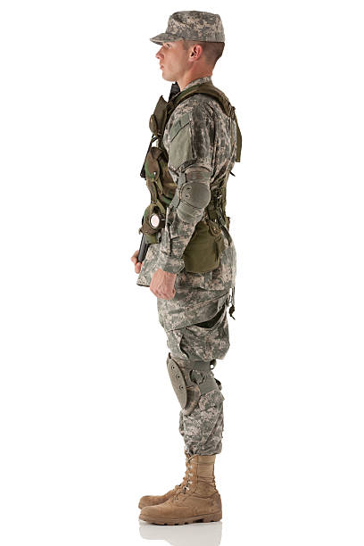Profile of an army man standing Profile of an army man standing uniform cap stock pictures, royalty-free photos & images