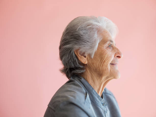 Profile of an elderly woman stock photo
