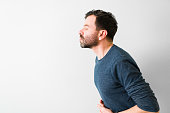 istock Profile of an hispanic guy giving a kiss to his partner 1296319132