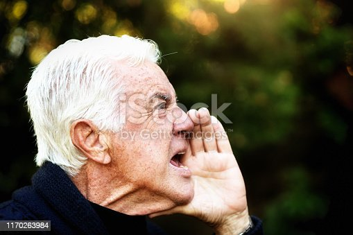 661896674istockphoto Profile of angry senior man shouting, hand to his mouth 1170263984