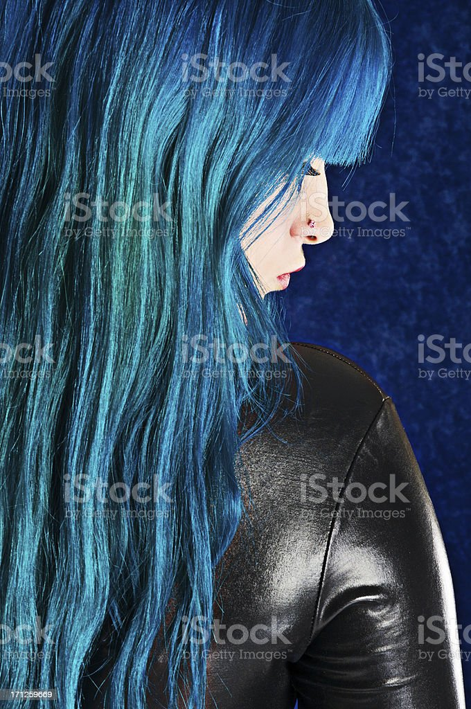 Profile of blue haired woman in black. stock photo