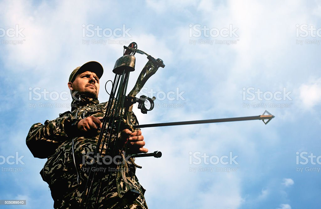 Profile of bowman with bow and arrow. stock photo
