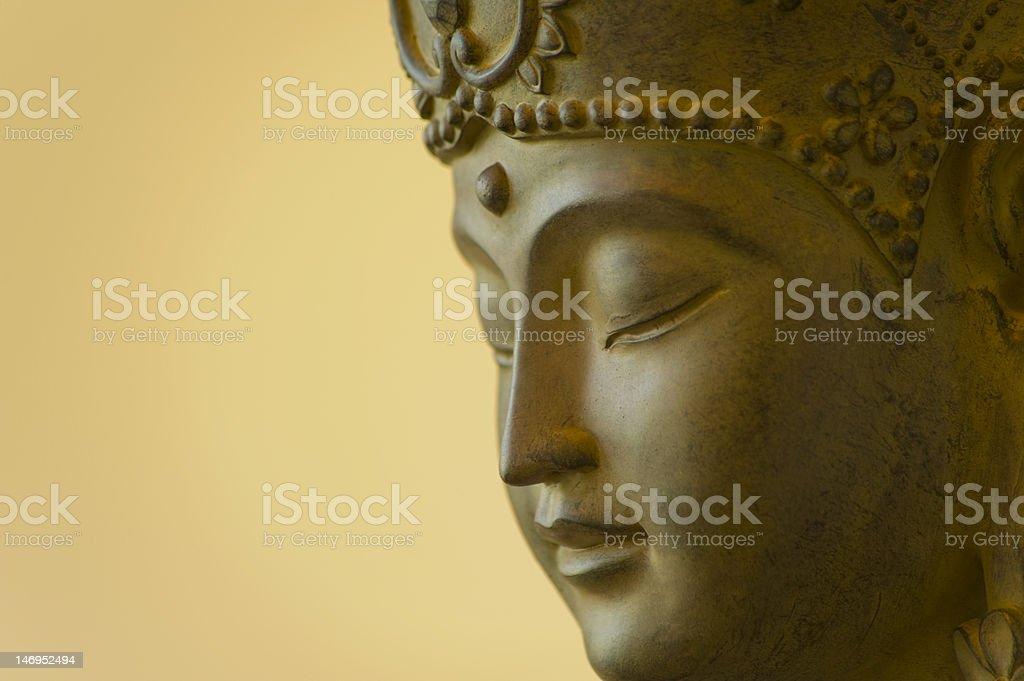 Profile of Buddha face stock photo