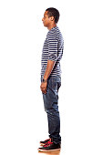 istock Profile of dark-skinned young man in jeans and blouse 531643913