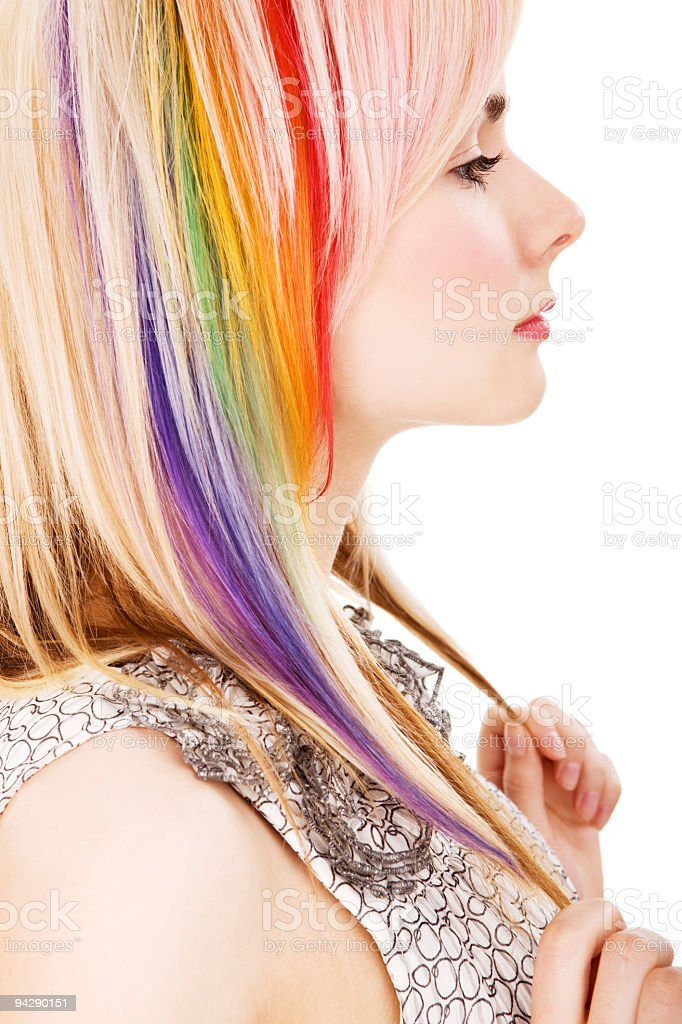 Profile of girl holding the ends of her rainbow colored hair stock photo