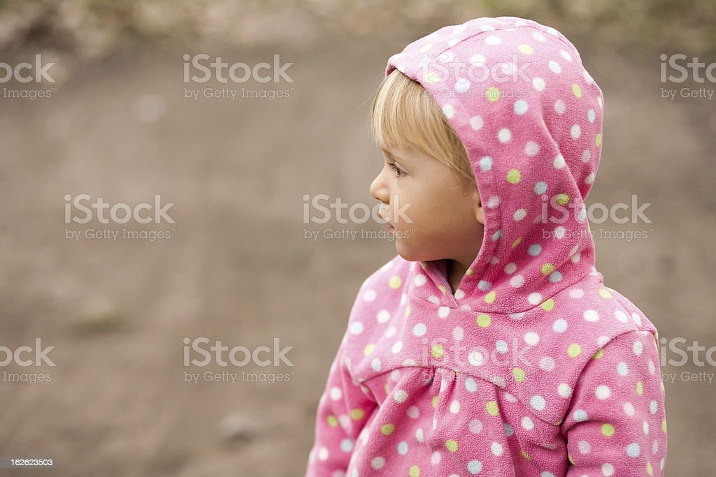 profile of little girl in a hood royalty-free stock photo