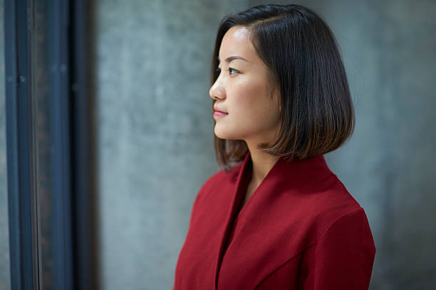 profile of one young asian businesswoman indoor stock photo