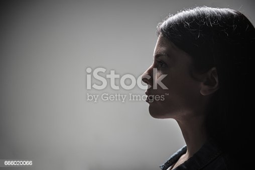 istock Profile of serious woman looking straight 666020066
