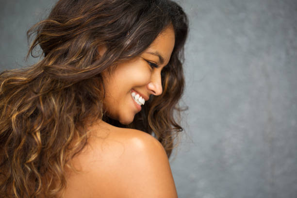 Profile of Smiling Young Gorgeous Mixed Race Woman stock photo