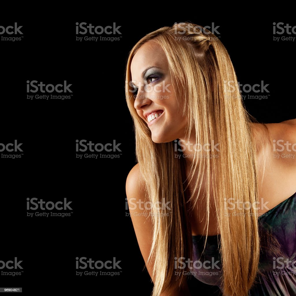 Profile of Smiling Young Woman with Long Blonde Hair royalty-free stock photo