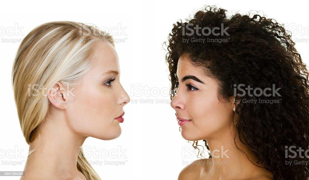 Profile of two women stock photo