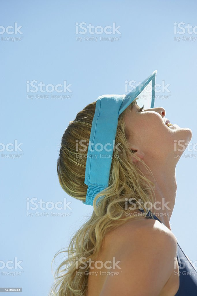 Profile of woman in visor outdoors stock photo