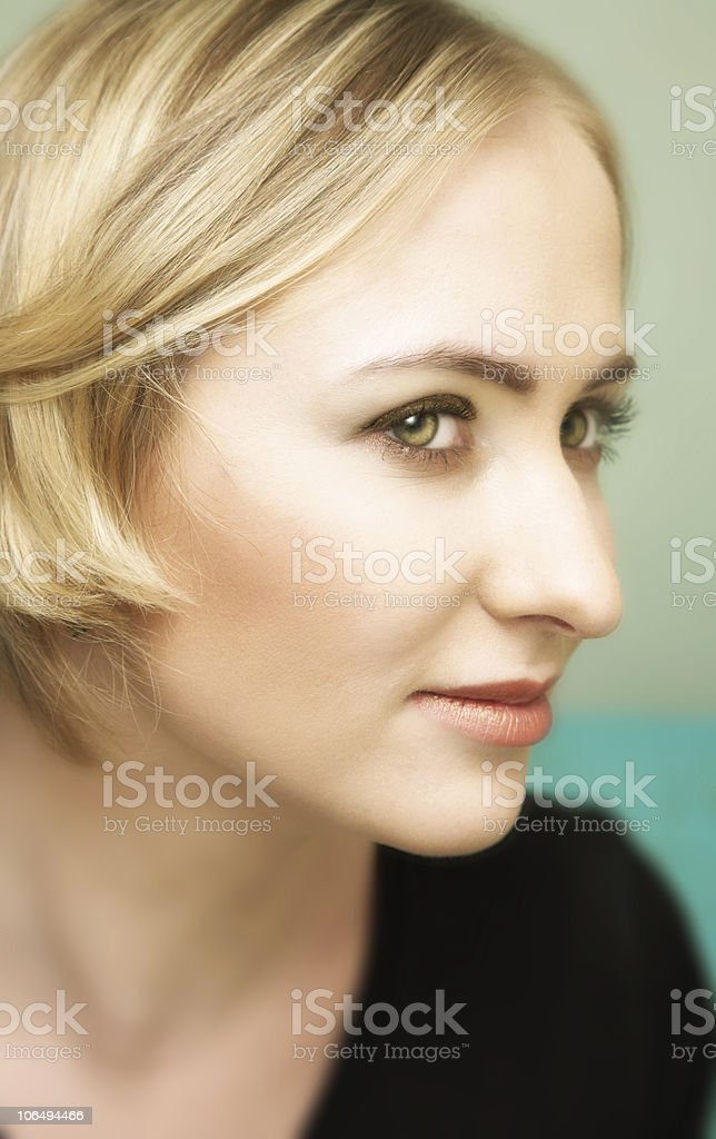 Profile of young blond woman with green eyes royalty-free stock photo