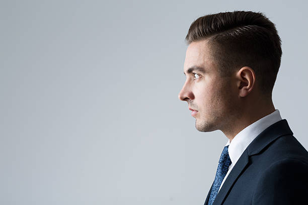 profile of young businessperson - side view stock photos and pictures