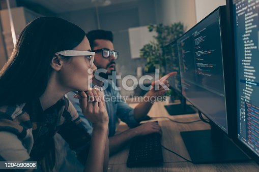 Profile photo of it specialist guy lady two business people night coworking watch, together indicate monitor testing debugging java script code smart professionals office indoors