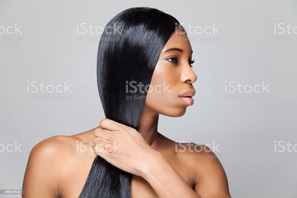 Profile picture of woman with black straight hair stock photo