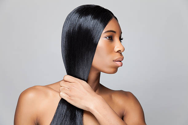 Profile picture of woman with black straight hair Beautiful young black woman with long straight hair straight hair stock pictures, royalty-free photos & images