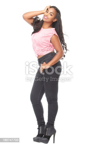 629077968istockphoto Profile portrait of a beautiful young woman smiling 185747703