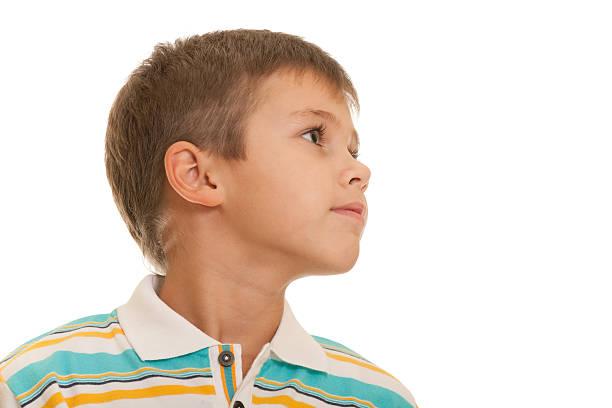 Profile portrait of a blond kid stock photo