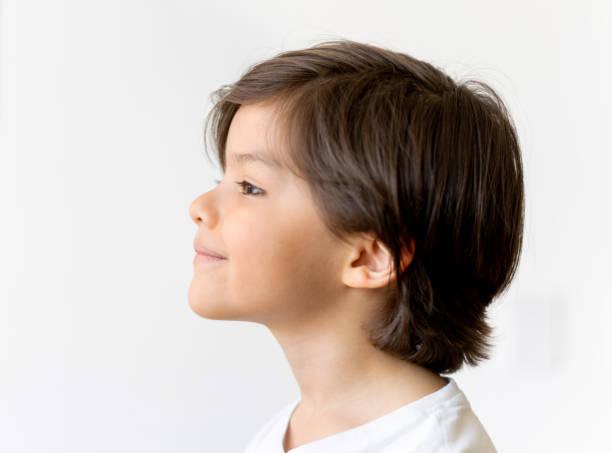 Profile portrait of a cute Latin American boy stock photo