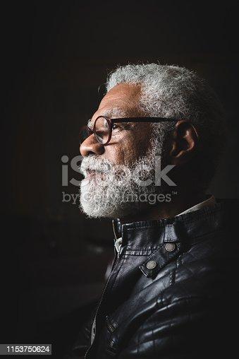 Profile portrait of a senior man with white beard