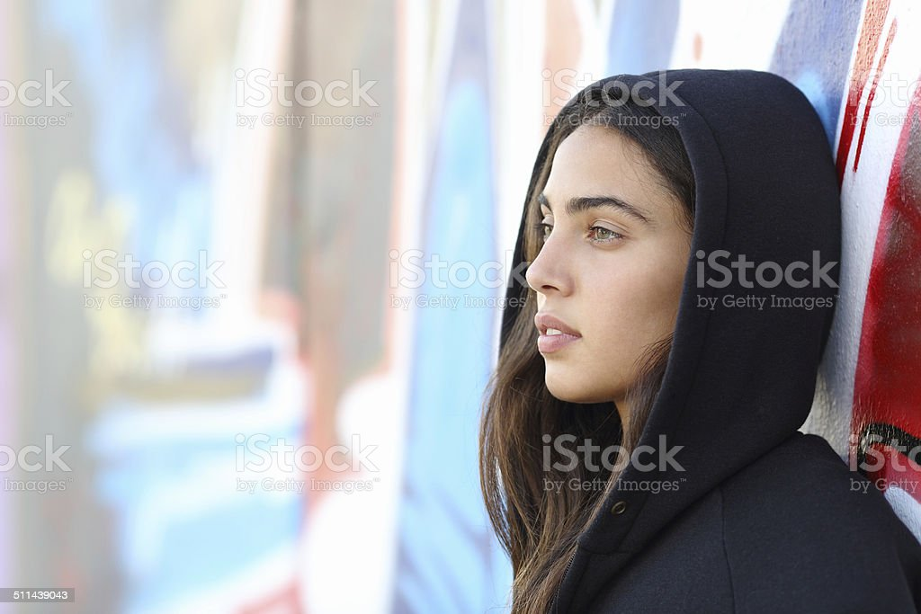 Profile portrait of a skater style teenager girl stock photo