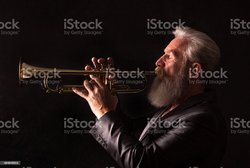 Profile Portrait of a trumpet player stock photo