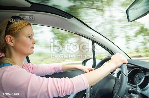 istock Profile portrait of serious calm woman carefullly safe driving 473528148