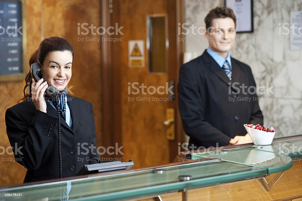 Profile shot of attractive executives at the reception - Royalty-free Adult Stock Photo