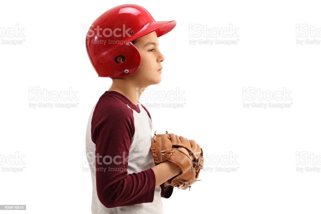 Profile shot of boy with baseball glove and helmet stock photo