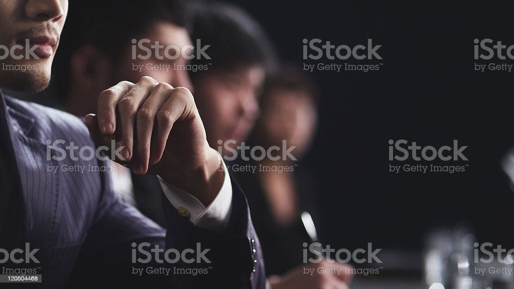 Profile shot of businessmen in a meeting stock photo