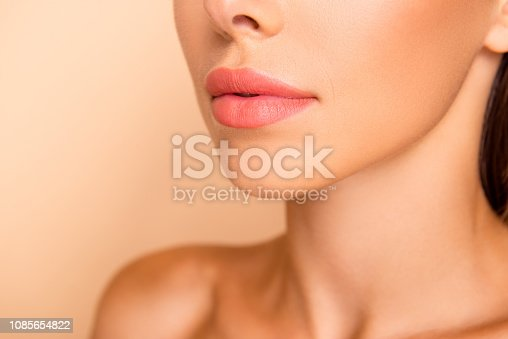 Profile side view cropped close up photo of dreamy sweet well-groomed lady with her shoulder she isolated on pastel beige background stand half turn to camera focus on lips