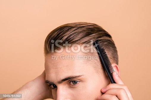 istock Profile side view cropped photo of young handsome man stylist make modern hairstyle, hairdresser isolated on pastel beige background 1049751202