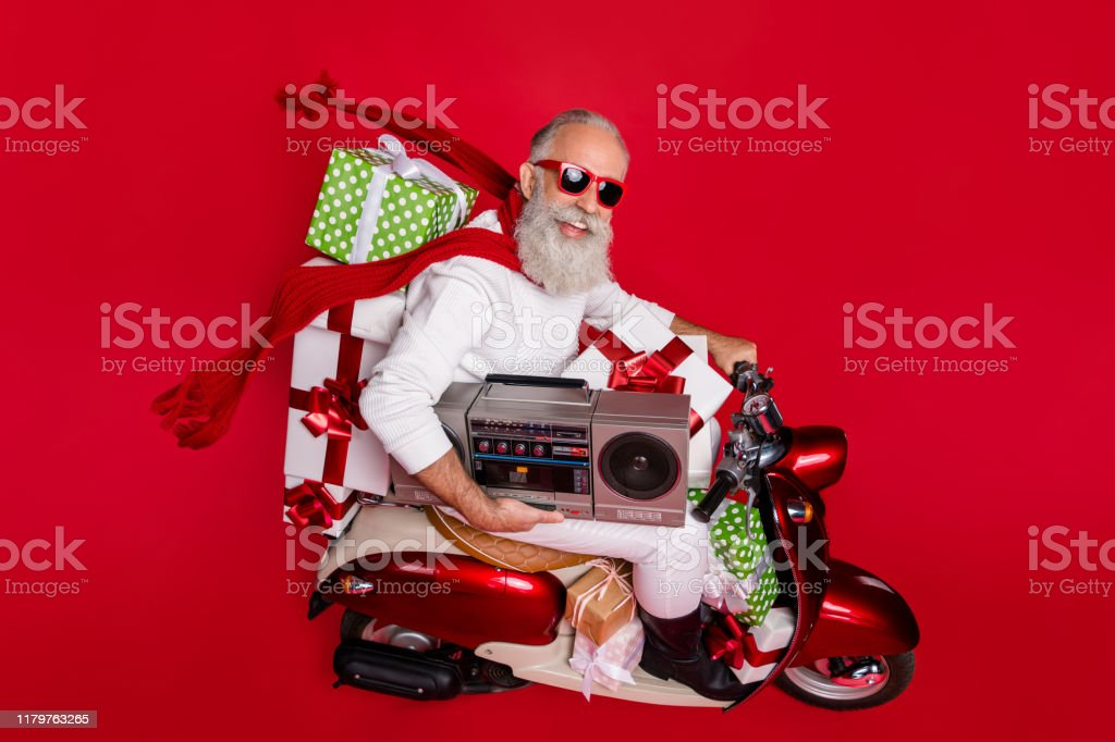 Profile Side View Of His He Nice Attractive Glad Cheerful Cheery Bearded Grayhaired Man Delivering Cool Desirable Purchase Things Festive Party Midnight Isolated On Bright Vivid Shine Red Background Stock Photo