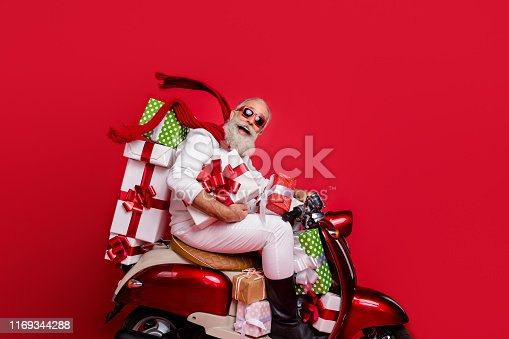 Profile side view of nice attractive funny funky cheery positive bearded gray-haired man driving motor carrying desirable purchase on-time air wind blows isolated on bright vivid shine red background