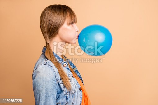 Profile side view photo of lovely teen, teenager feel positive cheerful tails weekend vacation free time look amazed stupor wear modern denim clothes beige background she her isolated