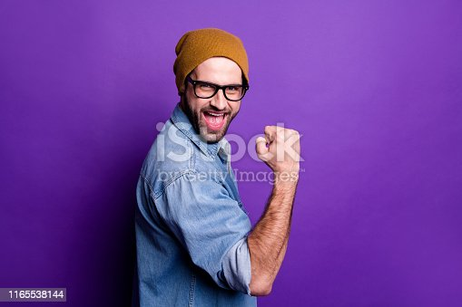 1165538246 istock photo Profile side view portrait of his he nice attractive cheerful cheery glad satisfied bearded guy showing yes gesture isolated over bright vivid shine violet lilac background 1165538144
