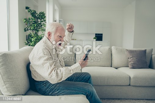 istock Profile side view portrait of mad stylish old man wearing checke 1124416597
