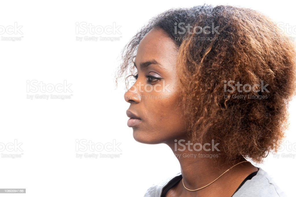 Profile view of a serious Beautiful black young woman stock photo