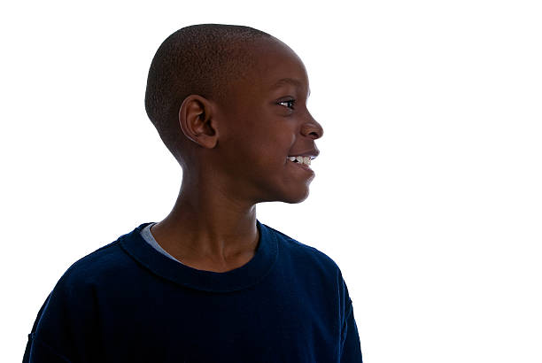 Profile view of a  Young African American boy smiling stock photo