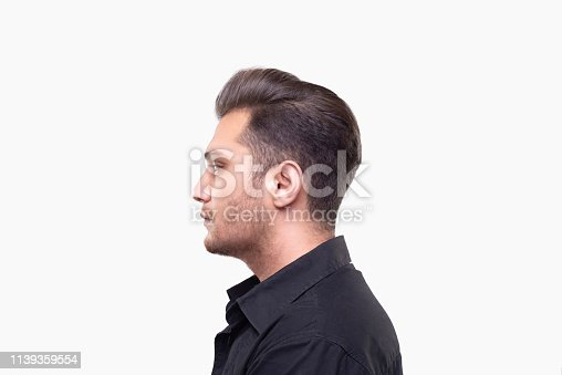 istock Profile view of a young man with blank expression over white background 1139359554